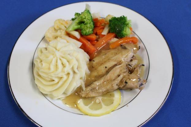 Plated Grilled Lemon Herb Chicken, Piped Whipped Idaho Potatoes, and Vegetable Medley