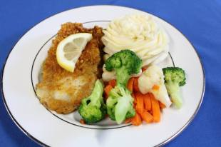 Plated Baked Tilapia, Piped Whipped Idaho Potatoes, and Vegetable Medley