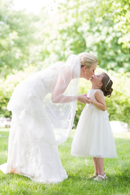 Bride and Flower Girl Kissing by Saint Charles Illinois Wedding Photographer